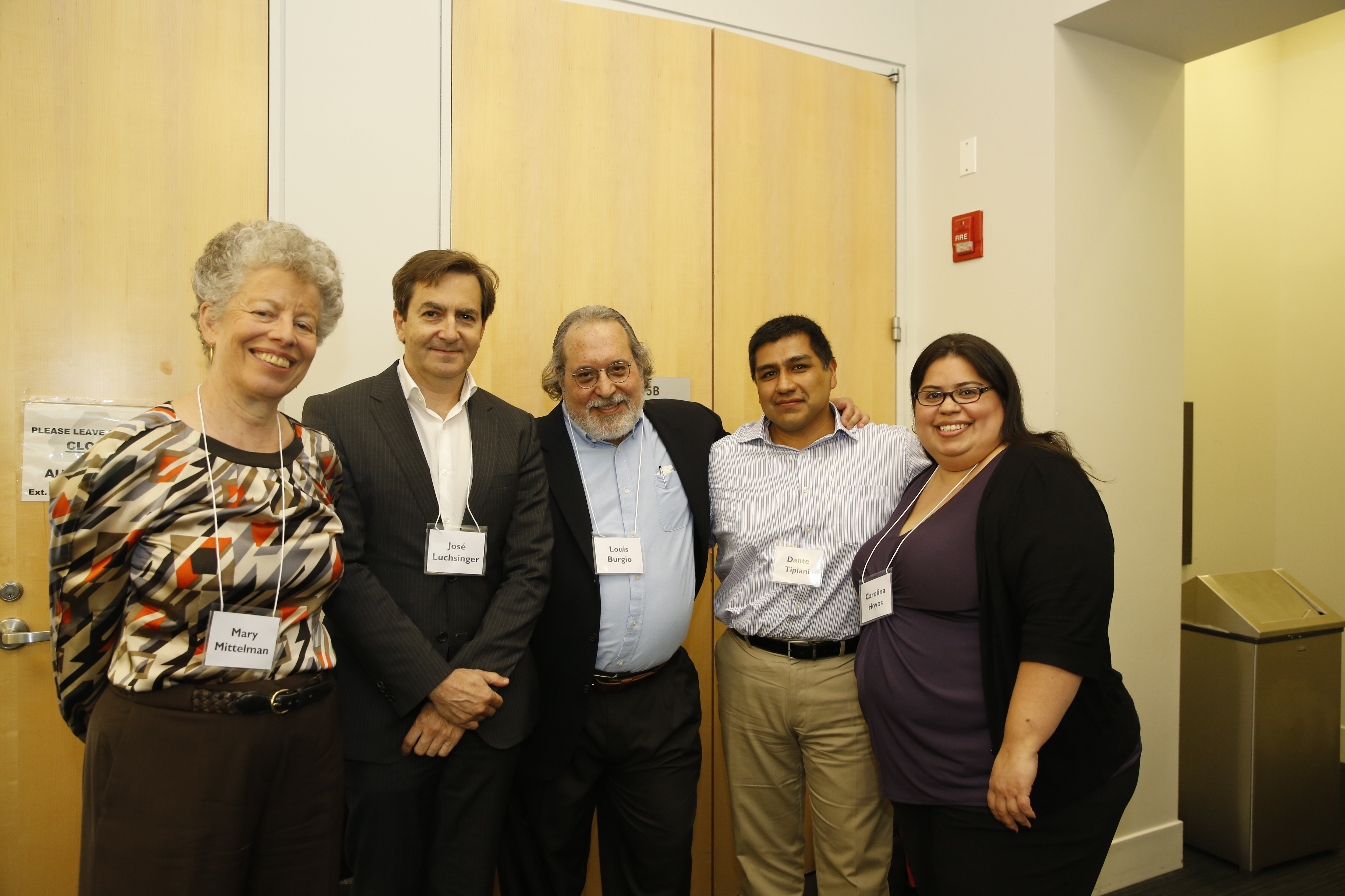 """Presenters on """"An Academic-Community Partnership Supporting Dementia Caregivers"""": Drs. Mary Mittelman, José Luchsinger, and Louis Burgio with Dante Tipiani and Carolina Hoyos."""